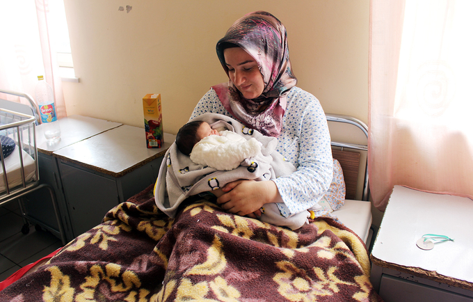Mother with her newborn daughter in Albania