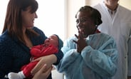 UNFPA Executive Director Dr. Natalia Kanem meets a newborn baby at a maternity hospital in Belarus