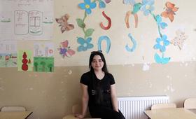 Student Alenda Bakhtiarova in a classroom at Karajala Public School