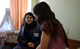 UNFPA mobile team member talks to a young woman in Ukraine